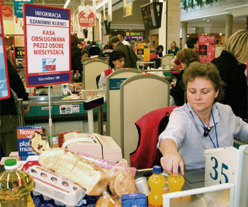 a person with hearing impairment working at the supermarket